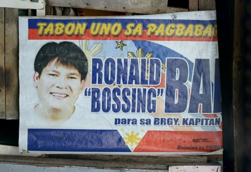 A campaign poster showing an image of Ronaldo Bae, who once ran in local elections for the post of village chief, hanging from a shanty house in Kawit, south of Manila, on January 4, 2013. Bae allegedly went on a rampage and killed five people on Friday, before dying in a gunbattle with police. (AFP)