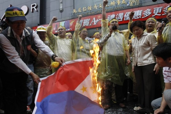 Taiwanese protesters burning the Philippine flag, protesting the Philippine Coast Guard actions of killing Taiwanese fishermen, off the coast of the Batanes.
